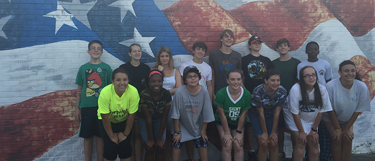 Youth Group in front of flag